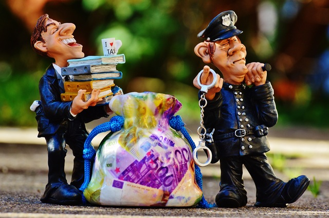taxes-tax-evasion-police-handcuffs