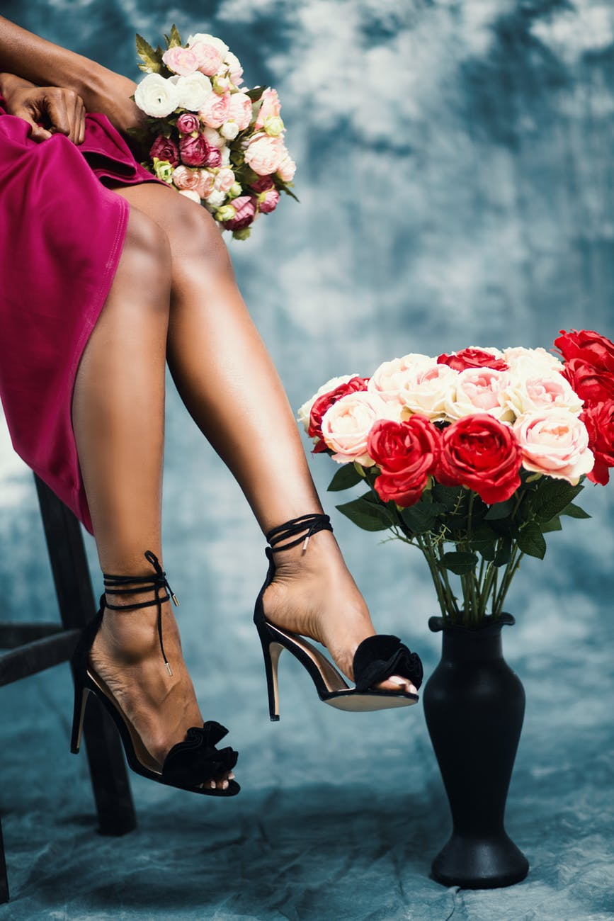 red and pink rose flower bouquet at woman s hand