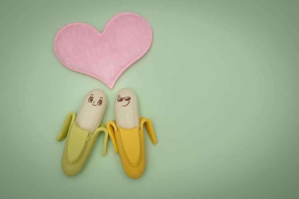 two green and yellow bananas plastic figures